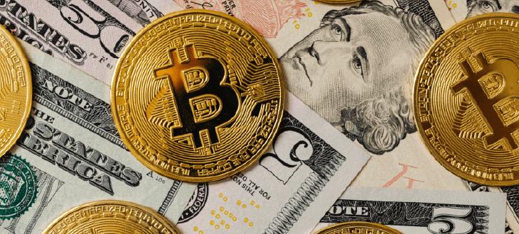 Bitcoin Coins and US Dollar Bills